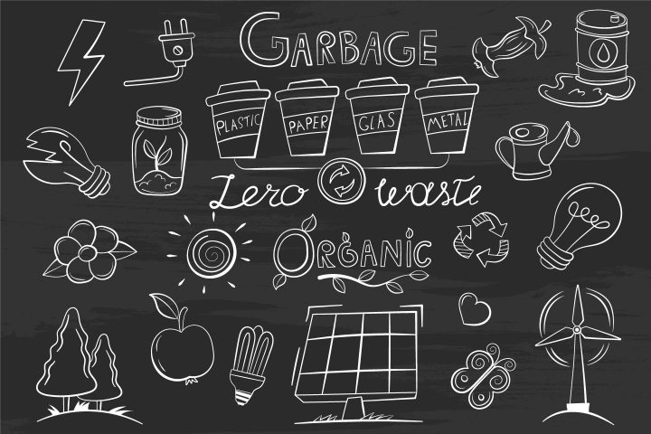 Collection of Objects on a Gray Board on the Theme of Ecology